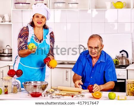 Senior family baking cookies at kitchen. Two retiree senior cook food at home. - stock photo