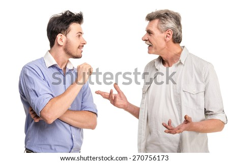 Senior father with adult son talking, isolated white background. - stock photo