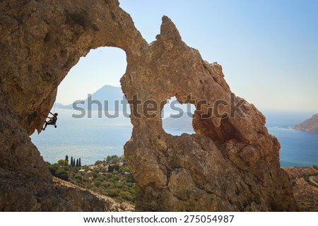 Senior female rock climber on a cliff. Kalymnos Island, Greece. - stock photo