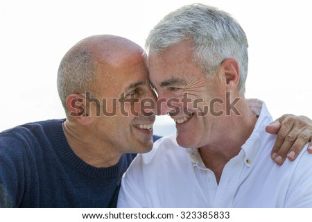 Senior Gay Male Couple Being Affectionate - stock photo
