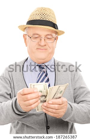 Senior gentleman counting money isolated on white background - stock photo