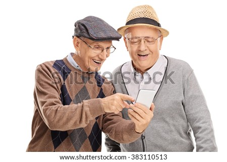 Senior gentleman showing something on his cell phone to his friend isolated on white background - stock photo