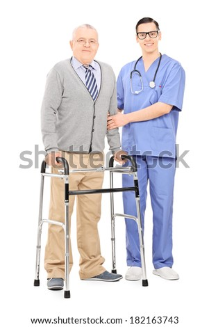 Senior gentleman with walker posing next to doctor isolated on white background - stock photo