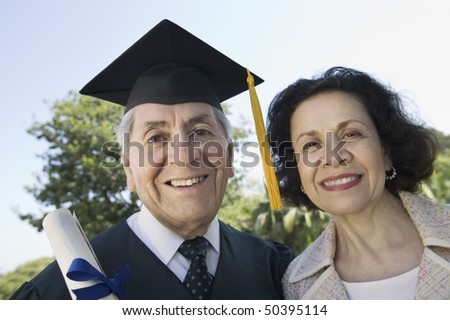 Senior graduate and wife outside, portrait - stock photo