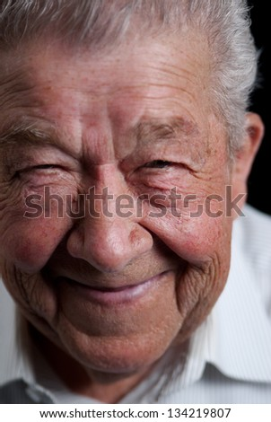 Senior grinning with delight - stock photo