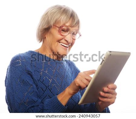Senior happy woman using computer isolated on white background  - stock photo