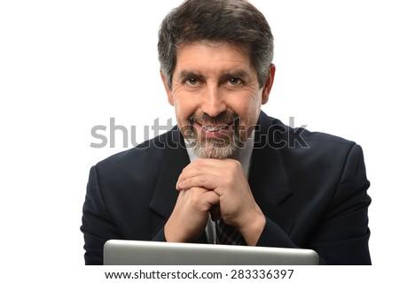 Senior Hispanic businessman using laptop isolated over white background - stock photo