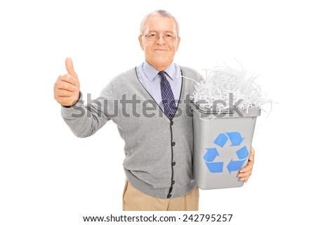 Senior holding a recycle bin and giving thumb up isolated on white background - stock photo