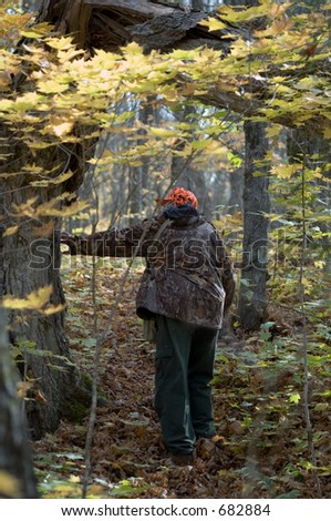 Senior hunter on the deer track by an Autumn day. Great atmosphere scene, Quebec. Canada - stock photo