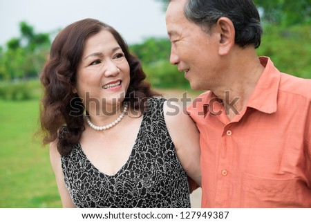 Senior husband and wife exchanging affectionate looks - stock photo