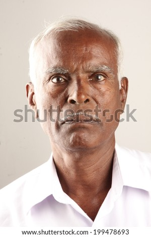 Senior Indian old man serious expression portrait - stock photo
