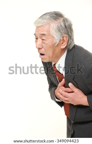 senior Japanese businessman heart attack - stock photo