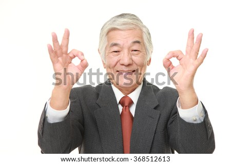 senior Japanese businessman showing double perfect sign - stock photo