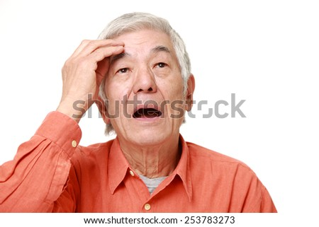 senior Japanese man has lost her memory - stock photo