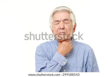 senior Japanese man having throat pain  - stock photo