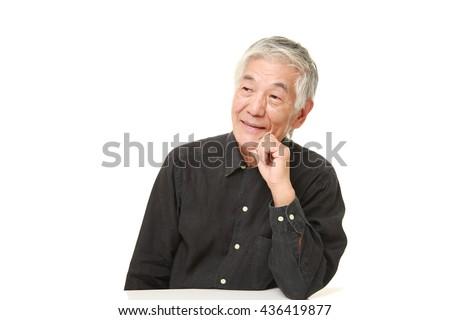 senior Japanese man in a black shirts dreaming at his future? - stock photo
