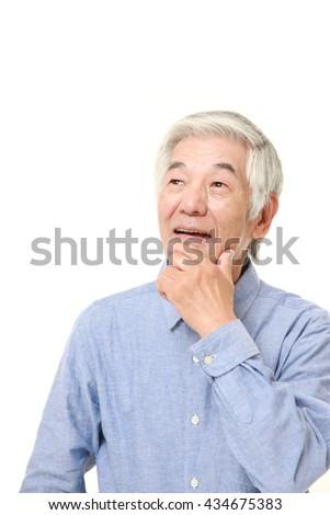 senior Japanese man in a blue shirts dreaming at his future - stock photo