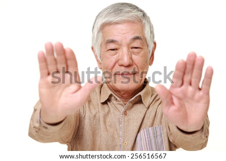 senior Japanese man making stop gesture - stock photo