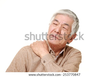 senior Japanese man suffers from neck ache - stock photo