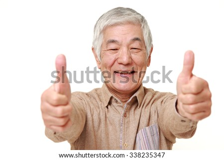 senior Japanese man with double thumbs up gesture - stock photo