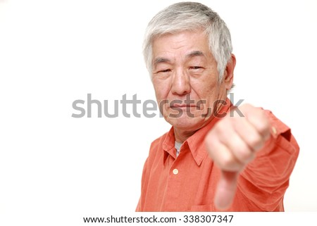 senior Japanese man with thumbs down gesture - stock photo