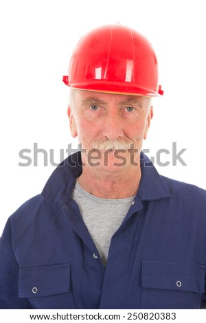 Senior laborer in blue work wear and red helmet isolated over white background - stock photo