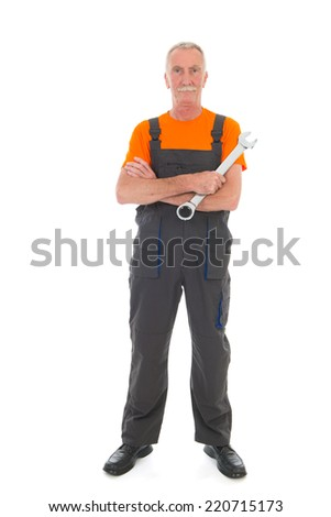 Senior laborer in orange and gray work wear with wrench isolated over white background - stock photo