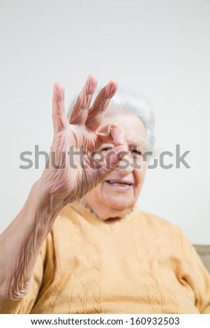senior lady making okay sign - stock photo