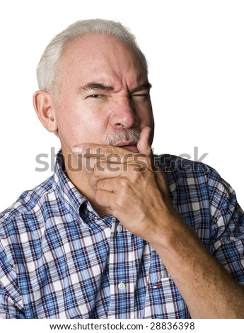 Senior Latino man puzzled, with hands on face - stock photo