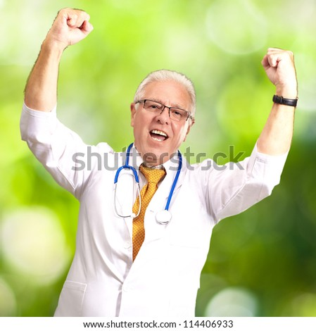 Senior Male Doctor In A Winning Gesture, Outdoor - stock photo