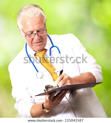 Senior Male Doctor Writing On Clipboard, Outdoor - stock photo