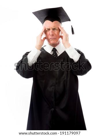 Senior male graduate suffering from headache - stock photo
