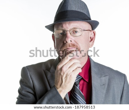 Senior male in a suite and hate thinking or observing isolated on white. - stock photo