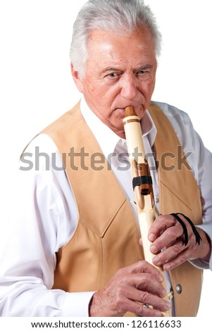 Senior male playing native american indian flute - stock photo