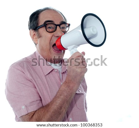 Senior male screaming loudly in a megaphone - stock photo