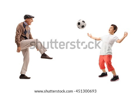 Senior man and a kid passing a football isolated on white background - stock photo