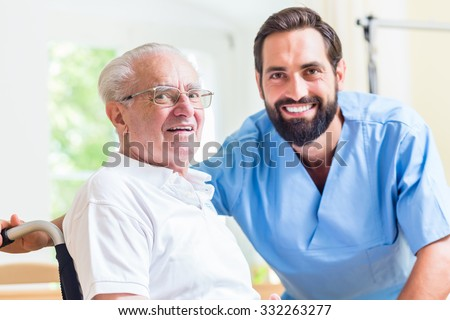 Senior man and nurse in rest home - stock photo