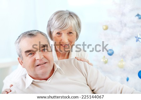 Senior man and woman looking at camera - stock photo
