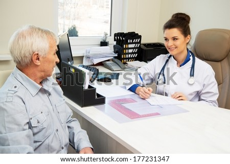 Senior man at doctors's office appointment  - stock photo