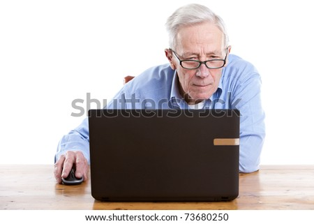 Senior man behind his computer looking interested on white background - stock photo