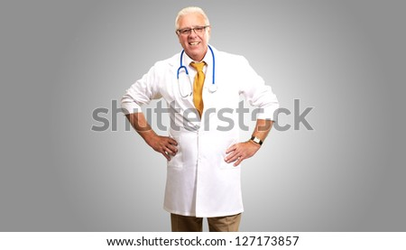Senior Man Doctor With Hand On Hip Isolated On gray Background - stock photo