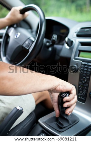 senior man driving a car (shallow DOF) - stock photo