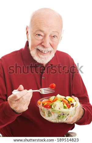 Senior man eating healthy salad for lunch.  White background. - stock photo