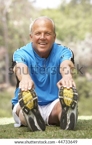 Senior Man Exercising In Park - stock photo