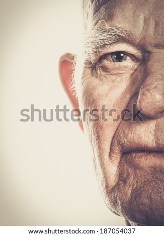 Senior man face close-up - stock photo