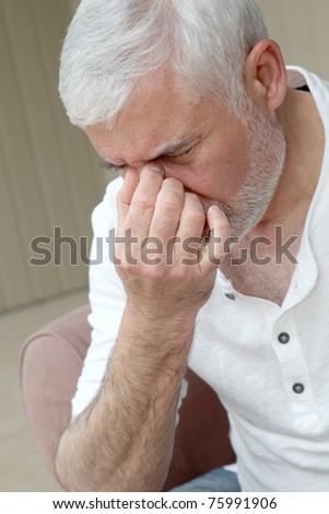 Senior man having a headache - stock photo