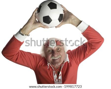 Senior man holding football above head, portrait - stock photo