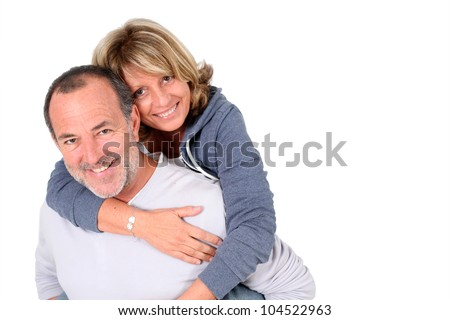 Senior man holding wife on his back - stock photo