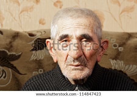 Senior man in casual head and shoulders portrait - stock photo