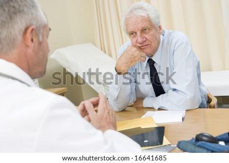 Senior man in doctor's office - stock photo